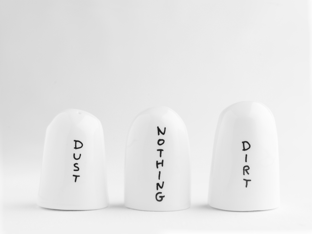 Salt and pepper shakers with 'Dust', 'Dirt', and 'Nothing' written on them